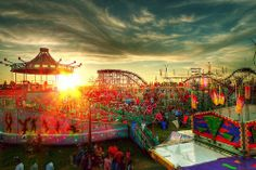 colorful carnival/fair scene at sunset