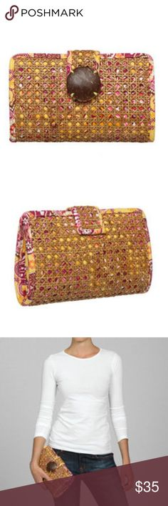 Vera Bradley Bali Gold Tiki Clutch In like new condition.  Don't know that I ever used it.  Bright 'Bali Gold' colors peak through the caning of this Vera Bradley tiki clutch. Featuring a roomy interior with zippered and slip pocket, contrasting fabric and a coconut-shell snap closure.  Exterior: Bali Gold with a wicker frame Entry: Flap-top with magnetic snap closure Lining: Contrast fabric Interior pockets: One zipper pocket and one slip pocket 5.75 inches high x 9.5 inches wide x 2.25…
