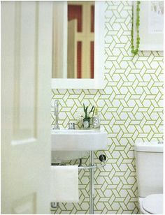 Manuel Canovas Trellis.  Another wallpaper idea to go above subway tile.  Would look great with white hex tile.