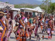 Timorese men in the traditional Tais dress in a ceremony