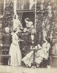 An early picture taken by the Victorian photographer Emma Johnston, showing a Mr Horn, his niece and other family and friends posing for the camera - Look at that scrumptious chair with attached(? Victorian Pictures, Vintage Pictures, Old Pictures, Old Photos, Victorian Life, Victorian London, Victorian Fashion, 1800s Fashion, Antique Photos