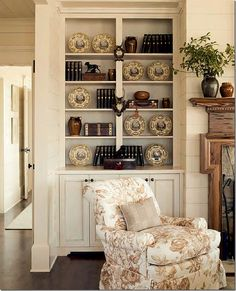 Love shelves on either side of a fireplace. These built-ins are great