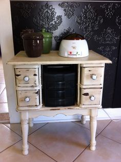 table made from top of sewing machine, drawers from old treadle machine and old end table