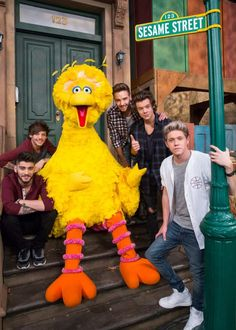 One Direction hangs out with Big Bird on Sesame Street