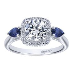 The blue sapphire and diamond ring you have been searching for. This can also be a blue sapphire ring if you want it that way. This Halo setting welcomes all kinds of stones.