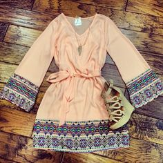 I love the accents and colors of this dress and the cute wedges