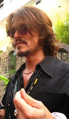 He is now 50 yrs old and although he has become a little eccentric - he still has gorgeous hair. This pic was maybe 2008, I think.