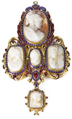 A carved opal, enamel and gold brooch, circa 1860 Set with five opal cameos, two carved to depict maidens in classical costume, three depicting warriors, each within a blue enamel border with white spot detail, to a gold scrolled surround with blue and red guiloché enamel detail, some enamel damage, one opal cracked, length 9.6cm.