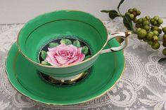 green vintage tea cup