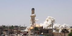A series of images have emerged which show the destruction of almost a dozen ancient shrines and Shia mosques in Isis-controlled territory in western Iraq. Pictured is the Shia Al-Qubba Husseiniya mosque in Mosul, Iraq