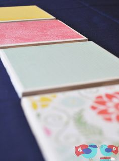 Design your own coasters using just cute scrapbook paper, Mod Podge, and bathroom tiles.