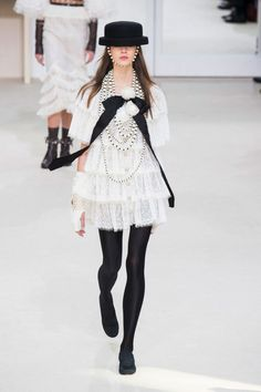 "Chanel - ""Leave it to Karl Lagerfeld to make a tiered lace minidress feel totally cool and edgy."""