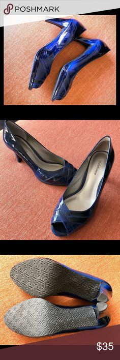 """Liz Claiborne """"Flirt"""" heels Liz Claiborne """"Flirt"""" heels Worn once These are really cool swirl like blue/black giving a different but stunning look at different angels. Very comfortable.  Size 8 Liz Claiborne Shoes Heels"""