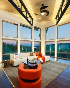 Open living room with a vaulted ceiling, modern furniture and ceiling fan, over looking Lake Nighthorse...