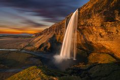 Seljalandsfoss is one of the most famous waterfalls of Iceland , is situated in between Selfoss and Skógafoss at the road crossing of Route 1 (the Ring Road) with the track going into Þórsmörk.