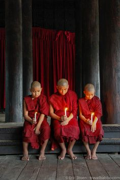 Places to go in Burma: Monks with candles at the Shwe Kyin Monastery