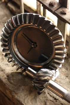 This clock is made of gears from the transmission from a Nascar's Brad Keselowski. These are hand made, one of a kind items so keep in mind that all pieces will vary. Photo by Chris Hornaday