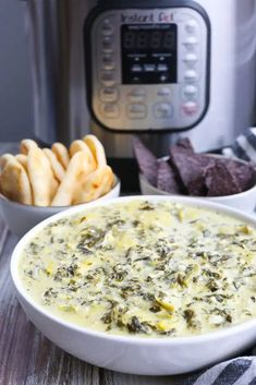 Instant Pot Spinach Artichoke Dip--the best and SO easy! Just dump everything in the Instant Pot and DONE. This is such an easy appetizer and frees up room in your oven at holiday meals!