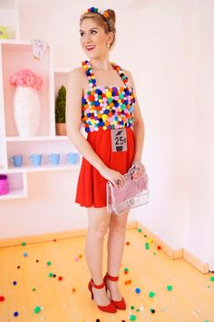 We are obsessed with this creative costume from the blog The Joy of Fashion. The best part is that it's super-affordable for gals on a budget and can be recreated by embellishing items you may already own with colorful pom-poms.