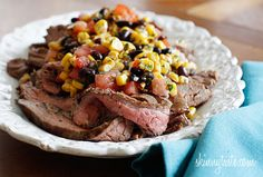 Grilled Flank Steak with Black Beans Corn and Tomatoes - This steak dish has a fiesta of flavors, the flank steak is seasoned with cumin and garlic and grilled to perfection, then topped with a fresh black bean, corn and tomato salad for a quick and tasty family friendly weeknight meal. 6points+ #weightwatchers #lowcarb