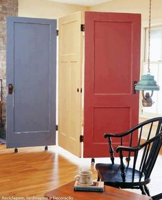 Fantastic reuse idea for old doors, repurposing into room dividers/screens - and on wheels to move wherever you need it. Inspired!