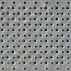 Seamless texture of grey sheet metal with holes punctured in even patterns.