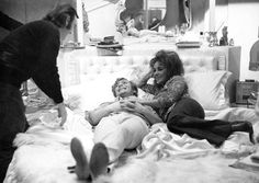 Michael Caine and Elizabeth Taylor relax on a bed during the filming of 'Zee & Co.' at Shepperton Studios, Buckinghamshire, England, Feb. 3, 1971. (AP Photo/Bob Dear)