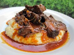 Plain Chicken: BBQ Pot Roast over Cheddar Ranch Grits! I have to try this...her favorite Pot Roast. They are all my favorites :) Can't wait to taste this on a baked potato.