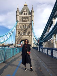 Aimee song standing on the tower bridge in London