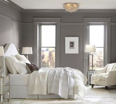 I like the picture rail molding in this Pottery Barn Master bedroom photo. the Capiz Floral Oversized Flushmount Ceiling Fixture is lovely as well