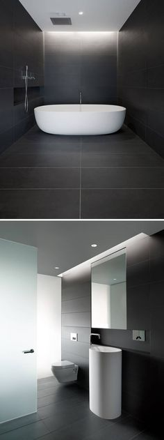 Bathroom Tile Ideas - Use Large Tiles On The Floor And Walls // Large dark tiles covering the floor and walls of this bathroom create beautiful lines that meet up seamlessly to create a calm, relaxing space.