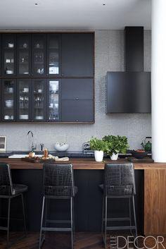 penny tile backsplash, black cabinets, wood countertops