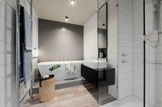 The bath in this bathroom is raised slightly to make the bathtub the focal point of the room.