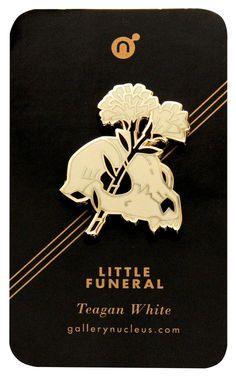 """GL: I find the """"Little Funeral"""" pin from artist Teagan White and Gallery Nucleus a beautiful symbol for beauty emerging out of darkness, life out of death, optimism in the face of despair. Further, I doubt it was intended as a political statement, but it certainly works as one these days."""