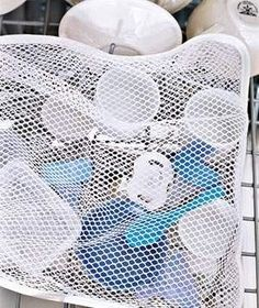 Use a mesh laundry bag to hold small items in your dishwasher. | 51 Insanely Easy Ways To Transform Your Everyday Things