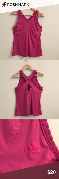 "Adidas Fuchsia Pink Crossover Workout Top Adidas fuchsia pink workout top in EUC. Size L. Climalite. There is a bra lining on the inside of the shirt. Measurements provided have been rounded up by quarters, halves, and whole inches.   Chest: 33"" Length: 24.75"" adidas Tops Tank Tops"