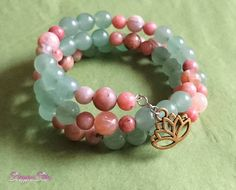 A beautiful memory wire wrap bracelet made with Green Aventurine, Sunstone, and Pink Lepidolite gemstone beads. This is a one size fits all. Memory Wire Bracelets, Beaded Bracelets, Amber Ring, Vintage Crafts, Green Aventurine, Stones And Crystals, Bracelet Making, Gemstone Beads, Unique Jewelry