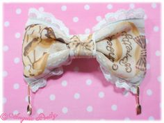 Melty Cream Donuts Barrette - Ivory $33.00 Part of the Melty Cream Donut collection! Fabric: Original print chiffon (100% Polyester) - 2013