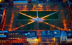 A night-time aerial view of Queen Square in Bristol