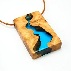 This pendant is inspired by the randomness and beauty of nature, we hope you like this piece which aims to resemble a river cutting through the land _____________________________________________ #balconystudio #nature #wood #resin #woodjewelry #river #pendant #statementnecklace #statementjewelry #etsy #etsyshop #resinjewelry #etsyjewelry #blue #water #river #handmadejewelry #oneofakind #jewelryaddict #jewellery #bohostyle