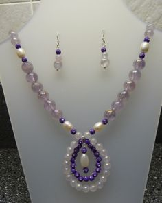 Made with fresh water pearls and genuine gemstones