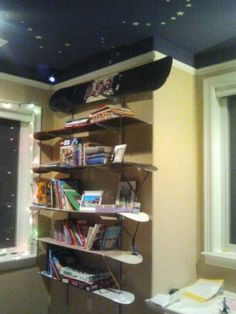 Snowboard bookshelves in Quin's room