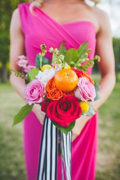 bridesmaid bouquet with fresh orange - photo by Teale Photography http://ruffledblog.com/best-of-2015-bouquets