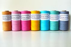 """A pretty Pink Bakers Twine with white stripes. Eco-luxe bakers twine and is great for gift wrapping, crafts projects, wedding favors, wedding decorations, and gift packaging.240 yards per spool100% Cotton  4-plyMade in USABio-degradableWound on cardboard tubeSpool dimensions are 2"""" diameter by 4"""" tall $15.00"""