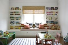 Playroom built in shelves, window seat, and drawers. Anna Spiro via Moss Eclectic.