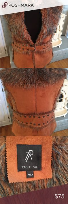 Rachel Zoe Furry Vest Beautiful richly colored Rachel Zoe faux fur vest. This vest has a furry inside and Studded embellishments on the outside. It has a buckle closure. Perfect for layering. This vest is a size large. Rachel Zoe Jackets & Coats Vests
