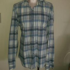 Blue plaid H&M button down shirt Lumberjack Chic, size medium, 100% soft cotton. Regular cut. Comes with extra buttons. Good condition. Sized Medium but would fit a misses 12-14 comfortably. Size 16-18 could wear it with some buttons open. Great for layering! H&M Tops Button Down Shirts