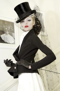 Veiled top hat, riding crop and outfit