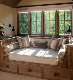 The perfect use for a dormer. A fabulous reading area with storage.