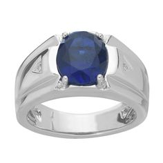 This elegant ring is crafted from fine sterling silver. The oval shaped created sapphire is embedded in the center of the ring with a prong setting. The uniquely shaped band has grooves on either side of the gemstone that highlight the diamond accents.